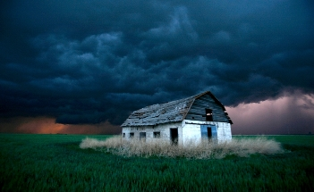 A white barn in the storm